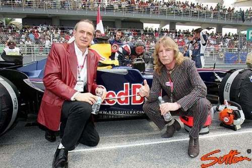 Francis and Rick with a Red Bull car on the grid at Sepang (copyright World@Sutton)